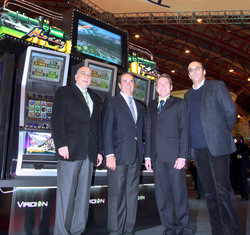 Pictured left to right with the Viridian Money Train Hyperlink, Fernando Fernandes da Silva, Managing Director, Casino Espinho and Casino Chaves; Manuel Soares de Oliveira Violas, Chairman, Solverde Group; Damien Greig, Regional Sales Manager, Aristocrat Technologies Europe; and Joel Santos Pais, Managing Director, Casino Vilamoura