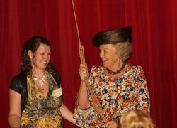 Queen Beatrix opened the curtain of the Flora theatre together with theatre director Elisabeth Looren de Jong during the official opening of the Flora building.