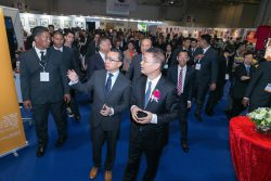 Government officials receive a guided tour of the MGS Entertainment Show exhibition floor.