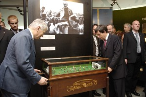 Secretary of the Interior Otto Schily (left)<br>plays at a historical football table.
