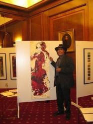 Künstler Georges Mirenes <br>vor seinem Gemälde Carmen